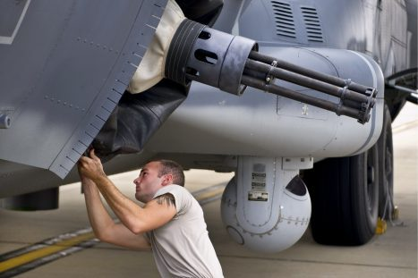 U.S. Air Force Staff Sgt. Johnathan Pierce, weapons load crew technician for 1st Special Operations Equipment Maintenance Squadron, prepares a 25 mm Gatling gun for aircraft departure on Hurlburt Field, Fla., Oct. 3, 2013. Hurlburt aircraft are relocating in preparation for the possible arrival of developing Tropical Storm Karen. (U.S. Air Force Photo/Staff Sgt.)